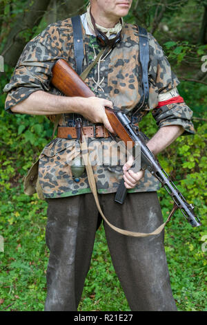 World War 2 reenacter dressed as a Polish resistance fighter and carrying a Russian PPSH-41 sub machine gun, at the Durham Light Infantry Museum, UK - Stock Photo