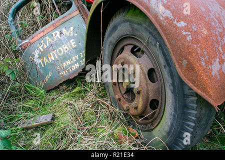 Abandoned old derelict and rusty 1940's Bedford M Series or O Series truck on waste ground surrounded by weeds and grass, County Durham UK - Stock Photo