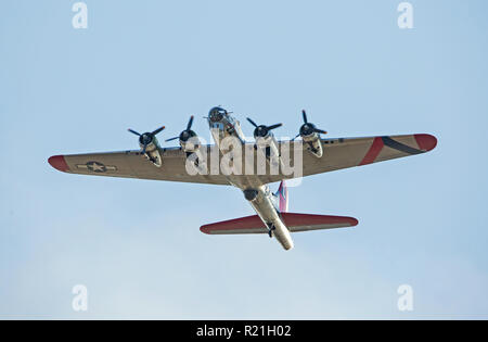 MONROE, NC (USA) - November 10, 2018: A B-17 'Flying Fortress' in flight against a clear blue sky at the Warbirds Over Monroe Air Show. - Stock Photo
