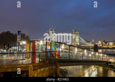 England,London- Tower  Millenium pier  terminal and boarding point for Thames River Services at night - Stock Photo