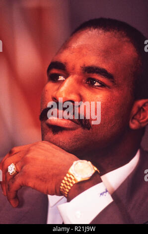Evander Holyfield during a press conference in Atlanta in 1991 announcing his match against George Foreman. Holyfield is an American former professional boxer who competed from 1984 to 2011. He reigned as the undisputed champion at cruiserweight in the late 1980s and at heavyweight in the early 1990s, and remains the only boxer in history to win the undisputed championship in two weight classes. Nicknamed 'The Real Deal', Holyfield is the only four-time world heavyweight champion, having held the unified WBA, WBC and IBF titles from 1990 to 1992. - Stock Photo