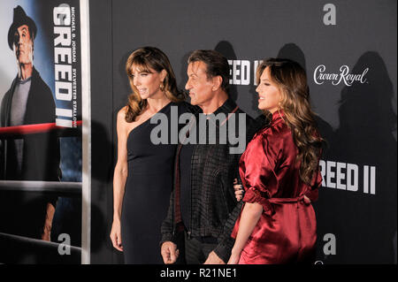 NEW YORK, NY - NOVEMBER 14: Jennifer Flavin, Sylvester Stallone and Sophia Rose Stallone attends 'Creed II' World Premiere at AMC Loews Lincoln Square - Stock Photo