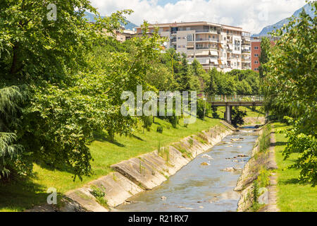 Tirana, Albania- 01 July 2014: Street of new Tirana town in beautiful sunny day. Lana River in the center of Tirana. Tirana is the capital and most po - Stock Photo