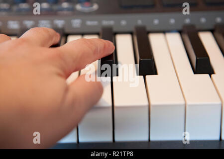 Fingers playing on a digital media keyboard or piano - Stock Photo