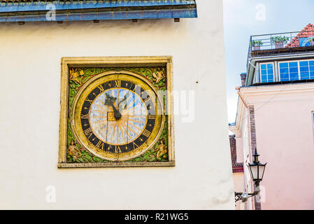 17th century clock on facade of the Church of the Holy Ghost, Tallinn, Harju County, Estonia, Baltic states, Europe. - Stock Photo