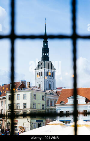The town hall square seen from a pharmacy window and the bell tower of the church of St. Nicholas. Tallinn, Harju County, Estonia, Baltic states, Euro - Stock Photo