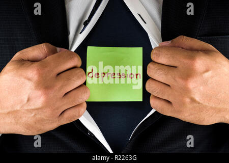 Hiding depression. A man in suit opening and unbuttoning his inner shirt to reveal his depression. Depression is written on a green sticky note. - Stock Photo