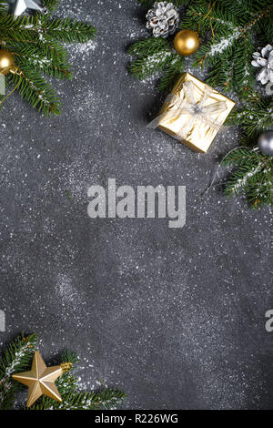 Christmas background with gold and silver decorations on black. - Stock Photo