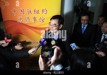 New York, USA. 15th Nov, 2018. Huang Ping (C), new Chinese consul-general in New York, speaks at a press briefing upon his arrival at New York's John F. Kennedy International Airport, the United States, on Nov. 15, 2018. The Chinese Consulate-General in New York will continue to be dedicated to promoting China-U.S. ties through boosting regional cooperation, the newly-arrived Chinese consul-general said here on Thursday. Credit: Li Rui/Xinhua/Alamy Live News - Stock Photo