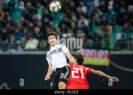 Leipzig, Germany. 15th Nov, 2018. Germany's Jonas Hector (L) vies with Russia's Aleksandr Erokhin during an international friendly match in Leipzig, Germany, Nov. 15, 2018. Germany won 3-0. Credit: Kevin Voigt/Xinhua/Alamy Live News - Stock Photo