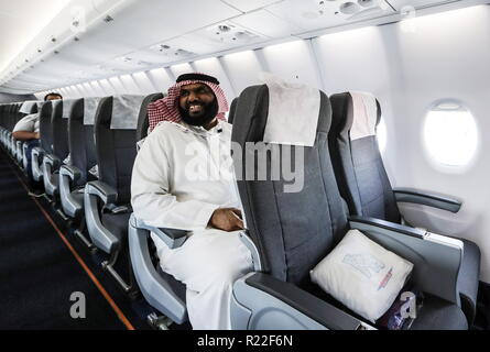Bahrain. 15th Nov, 2018. BAHRAIN - NOVEMBER 15, 2018: A man in a Sukhoi Superjet 100 aircraft (SSJ100) of the Yamal Airlines at the 2018 Bahrain International Air Show at the Sakhir air base in Bahrain. 33 military delegations from 19 countries and 20 civilian ones from 35 countries take part in the show. Sergei Savostyanov/TASS Credit: ITAR-TASS News Agency/Alamy Live News - Stock Photo
