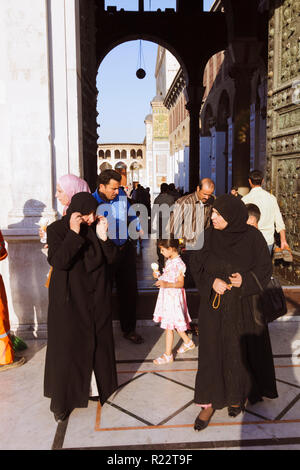 Damascus, Syria : People at the entrance of the, Umayyad Mosque, one of the largest and oldest in the world. - Stock Photo