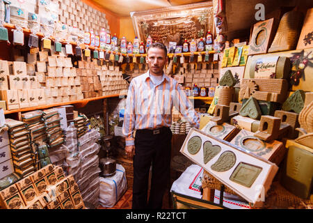 Aleppo, Aleppo Governorate, Syria : A vendor stands at his shop in al-Madina Souq displaying the famous Aleppo soap products. - Stock Photo