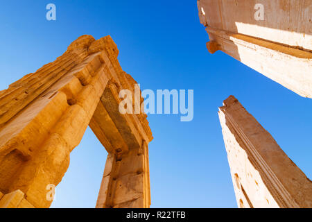 Palmyra, Homs Governorate, Syria - May 27th, 2009 :  Standing entrance arch of the destroyed cella of the Temple of Bel. Its ruins were considered amo - Stock Photo