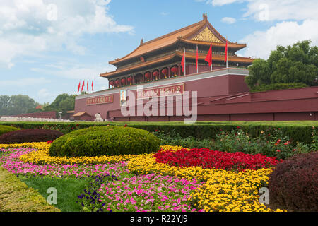 Tiananmen gate in Beijing, China. Chinese text on the red wall reads: Long live China and the unity of all peoples - Stock Photo