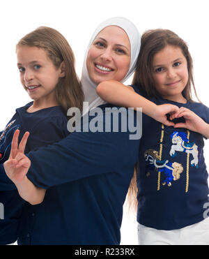 A Happy Muslim Family, Mother and Her Daughters Isolated on White Background - Stock Photo