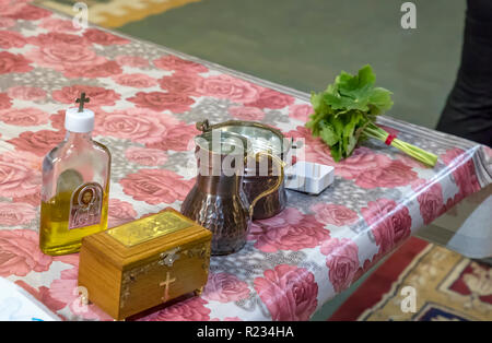 a box and the necessary accessories of a Christian priest and green geranium on the table in the church. Details in the Orthodox Christian Church - Stock Photo