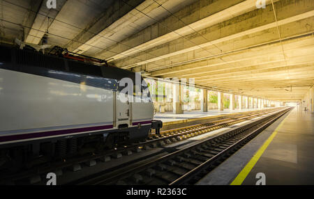 High speed electric train in the station and platform nobody, Spain - Stock Photo