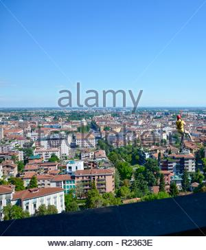 View from the city wall of Bergamo Upper Town towards the Lower Town, a person on a zip wire drive, summer - Stock Photo