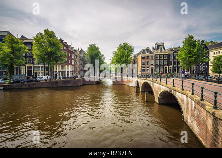 Famous Keizersgracht canal intersection in Amsterdam - Stock Photo