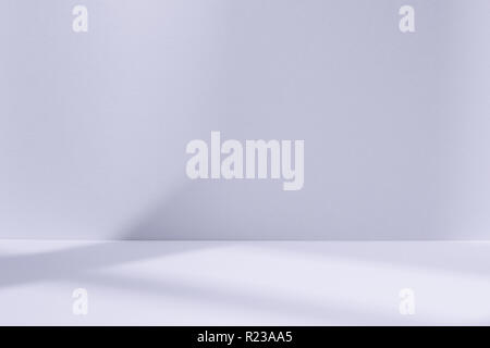 Empty light blue studio space with deep windows shadow. Sparse template and background - Stock Photo
