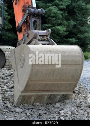 Mechanical Digger Bucket in a Stone Quarry, UK - Stock Photo
