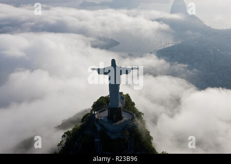 The giant Art Deco statue of Jesus, known as Cristo Redentor (Christ the Redeemer), on Corcovado mountain in Rio de Janeiro, Brazil. - Stock Photo