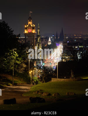 Edinburgh, Scotland, UK - November 6, 2011: Traffic forms light trails on Edinburgh's busy Prince's Street at night, as viewed from Calton Hill park,  - Stock Photo
