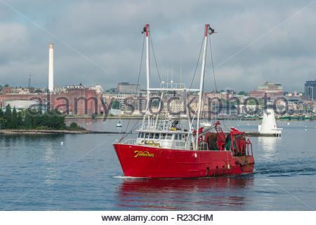 New Bedford, Massachusetts, USA - September 15, 2018: Commercial fishing vessel Fisherman crossing New Bedford harbor - Stock Photo