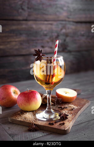 Hard apple cider (sangria, punch, fruit wine) for autumn and winter holidays - homemade festive Christmas, Thanksgiving drink on wooden table, copy sp - Stock Photo