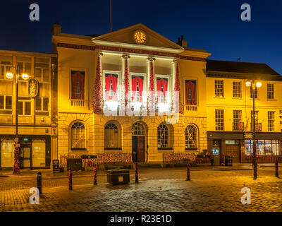 Ripon Town Hall floodlit ast dusk in the Market Place at Ripon North Yorkshire England - Stock Photo
