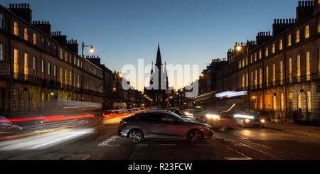 Edinburgh, Scotland, UK - November 1, 2018: The gothic spires of St Mary's Episcopalian Cathedral are silhouetted against a sunset at the end of Melvi - Stock Photo