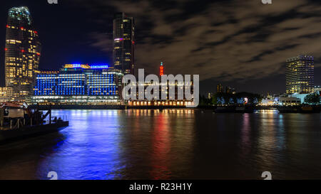 London, England, UK - September 14, 2018: The skyline of London's South Bank rises behind the River Thames at night, including One Blackfriars, Sea Co - Stock Photo
