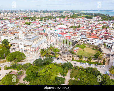 House of Wonders. Old Fort (Arab Fort built by Sultan of Oman). Stone Town, old colonial center of Zanzibar City, Unguja island, Tanzania. Aerial view - Stock Photo