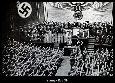 Photograph of a Reichstag Rally from the Kroll Opera House, in Berlin. Hitler addresses the Reichstag putting forward proposal for peace which was denounced by M. Daladier. Hitler is shown in the front row with Hess and Ribbentrop next to him. Dated 1939 - Stock Photo