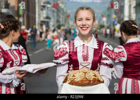 Belarus, the city of Gomel, September 15, 2018. Holiday City Day. Central Park.Belarusian woman in national Slavic costume with bread and salt.Belarus - Stock Photo