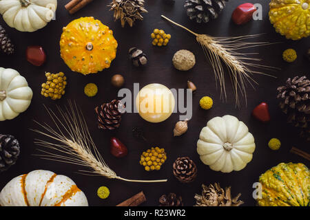 Autumn Collection with Yellow Aventurine Sphere, Red Jasper, Wheat, Heirloom Gourds, Acorns, Pinecones, Dried Artichokes and Cinnamon - Stock Photo