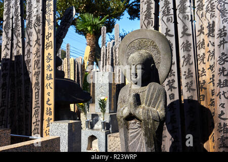 Buddah and wooden Toba tablets (memorial tablets) in a Japanese graveyard at Kyoji Buddhist Temple in Yanaka, Tokyo, Japan, Asia - Stock Photo