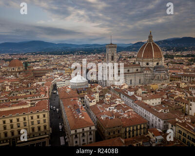 Aerial view of the Firenze Florence cathedral duomo with cloudy sky on a summer morning in Tuscany Italy - Stock Photo
