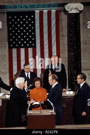 Gerald Ford, (1913 - December 26, 2006) 38th President of the United States, from 1974 to 1977, seen taking the oath as Vice President in 1973 while Richard Nixon looks on - Stock Photo