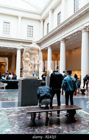 New York City, USA - June 23, 2018: Visitors at Greek and Roman Art Halls in the Metropolitan Museum of Art in New York - Stock Photo