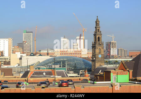 trinity shopping complex designed by chapman taylor leeds by trinity church built in 1722 yorkshire united kingdom - Stock Photo