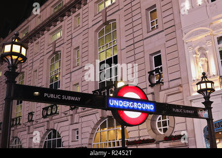 LONDON, UNITED KINGDOM  - NOVEMBER 12, 2018: Piccadilly Circus Station, illuminated entrance sign to world famous London Underground. - Stock Photo