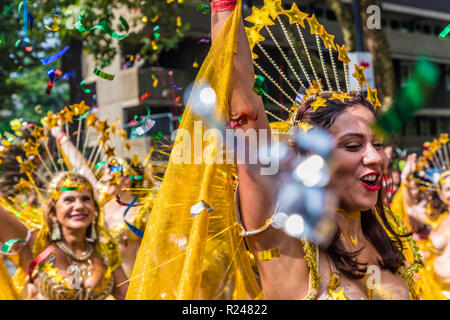 A colourfully dressed participant in the Notting Hill Carnival, London, England, United Kingdom, Europe - Stock Photo