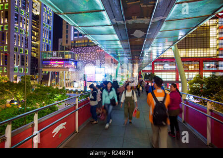 Xinyi downtown district, pedestrian bridge in the prime shopping and financial district of Taipei, Taiwan, Asia - Stock Photo