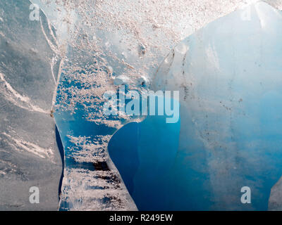 close up of an blue ice block from the Rhone Glacier, Switzerland - Stock Photo