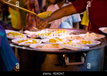 Fresh prepared indian vegetarian curry on rice served on street festival in Malacca. Traditional asian cuisine made of fresh ingredients. - Stock Photo
