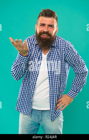 Come on. What are you talking about. Art of negotiations. Man try to persuade you in something. Hipster charismatic speaker try to persuade on turquoise background. Public talk and art of persuade. - Stock Photo