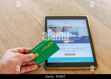 Paris, France - November 15, 2018 : French health insurance website, presenting the new 'shared medical file'(DMP), on a digital tablet. - Stock Photo