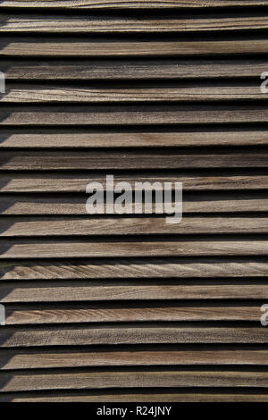 Wooden shutters on brown background in Key West, USA. Blinds with timber logs. Protection and shield concept - Stock Photo